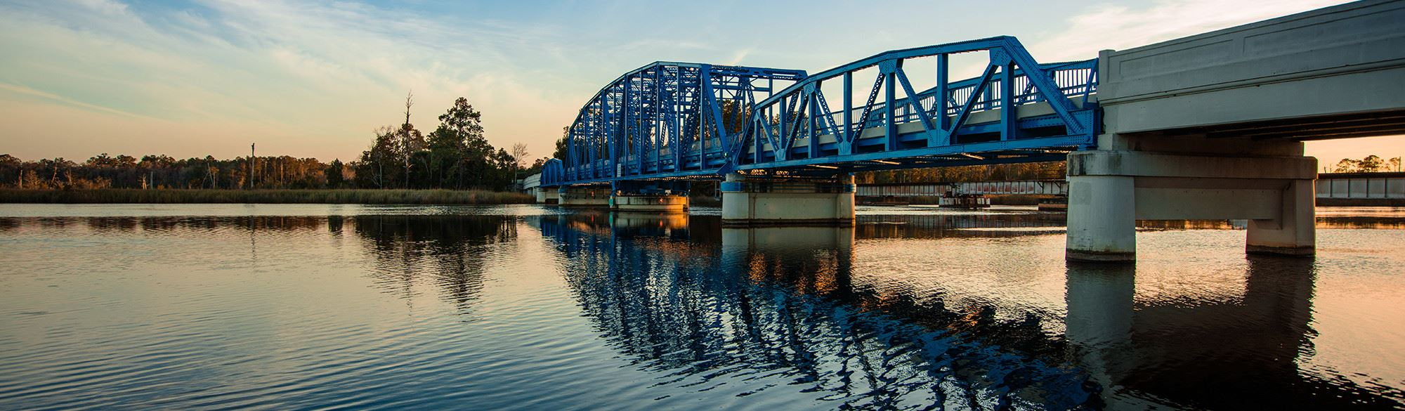 Blue Bridge Kingsland over water at sunset
