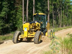 grader working on a county dirt road