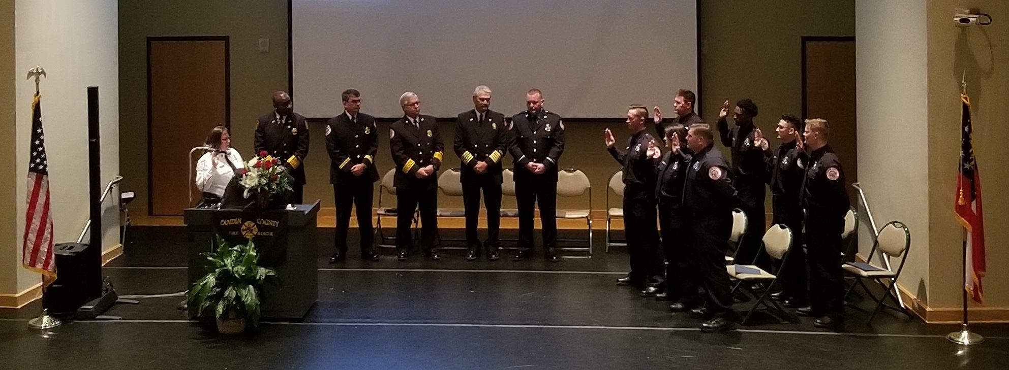 CCFR Leadership assist the new firefighters in taking their oath